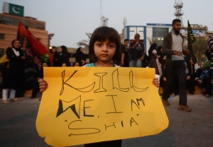 A young Shi'ite girl holds a placard at a protest in Quetta, 13 January.