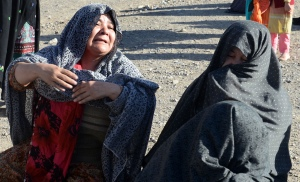 Mourners at the funeral of Shi'ite Muslims killed in a bomb blast in Quetta.