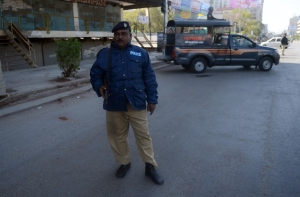 Policeman stand guard in Karachi, February 2013.