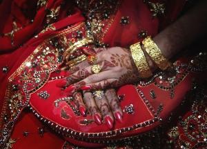 Pakistani bride Najma Khalil folds her h