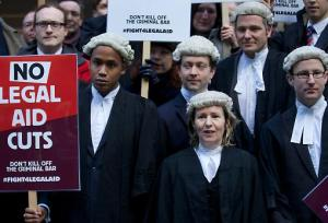 Lawyers protest against cuts to legal aid.